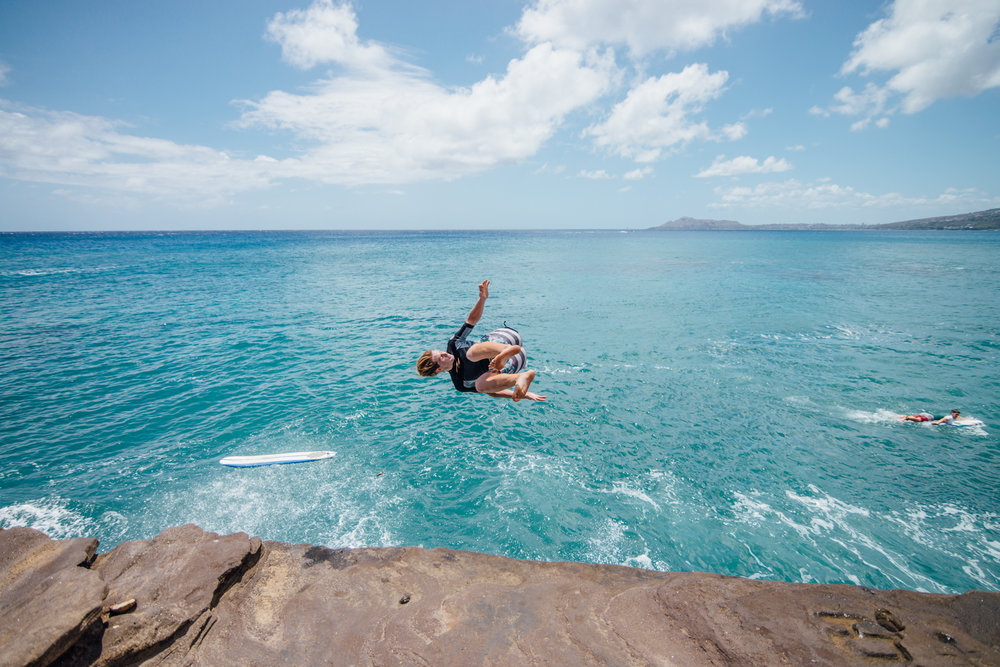 Caption (Image above): This picture was taken during a recent trip to Hawaii. A surfer jumps off the China Wall cliff located in Koko Kai (Oahu).