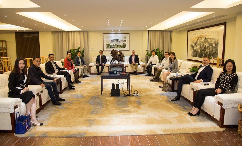 David Thomas and Chinese investors closing out a deal
