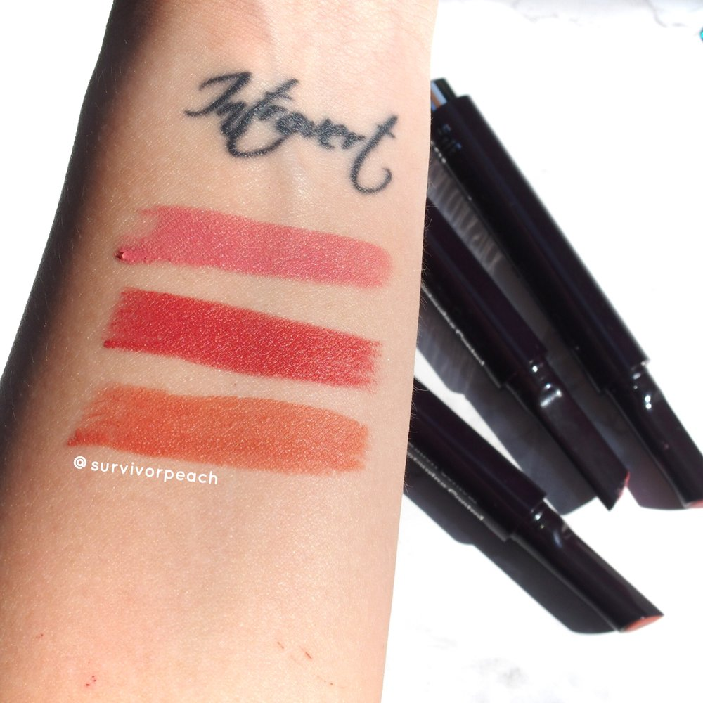 Thick swatches of the Rouge Expert Click sticks in #6 Rosy Flush, #11 Baby Brick, and #12 Naked Nectar.