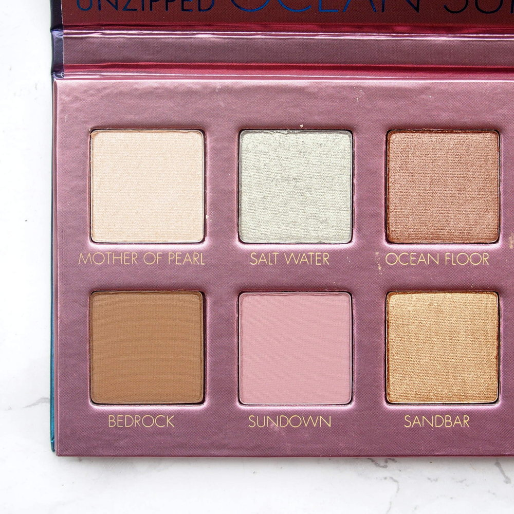 Left side of the Lorac Sunset Upzipped Palette