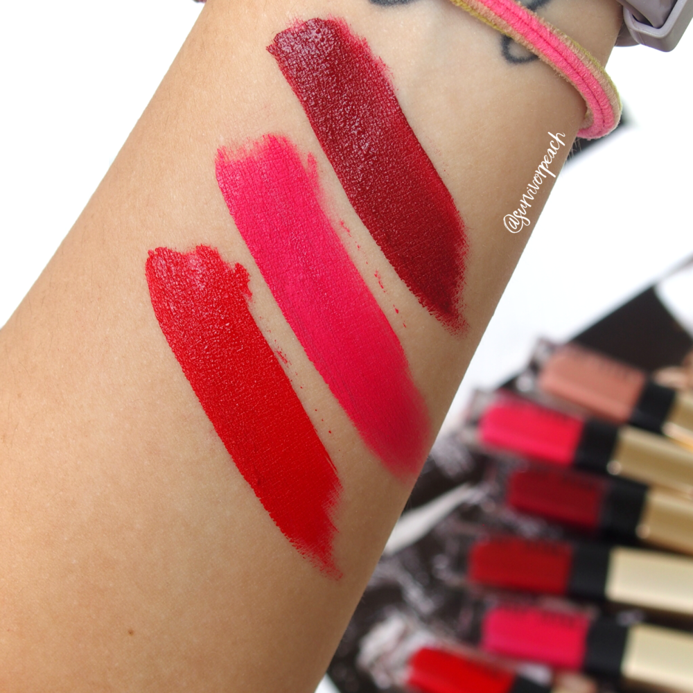 Swatches of the Bobbi Brown Luxe Liquid Lip Velvet Matte Lipsticks in Starlet Scarlet, Pink Shock, and Blood Orange.