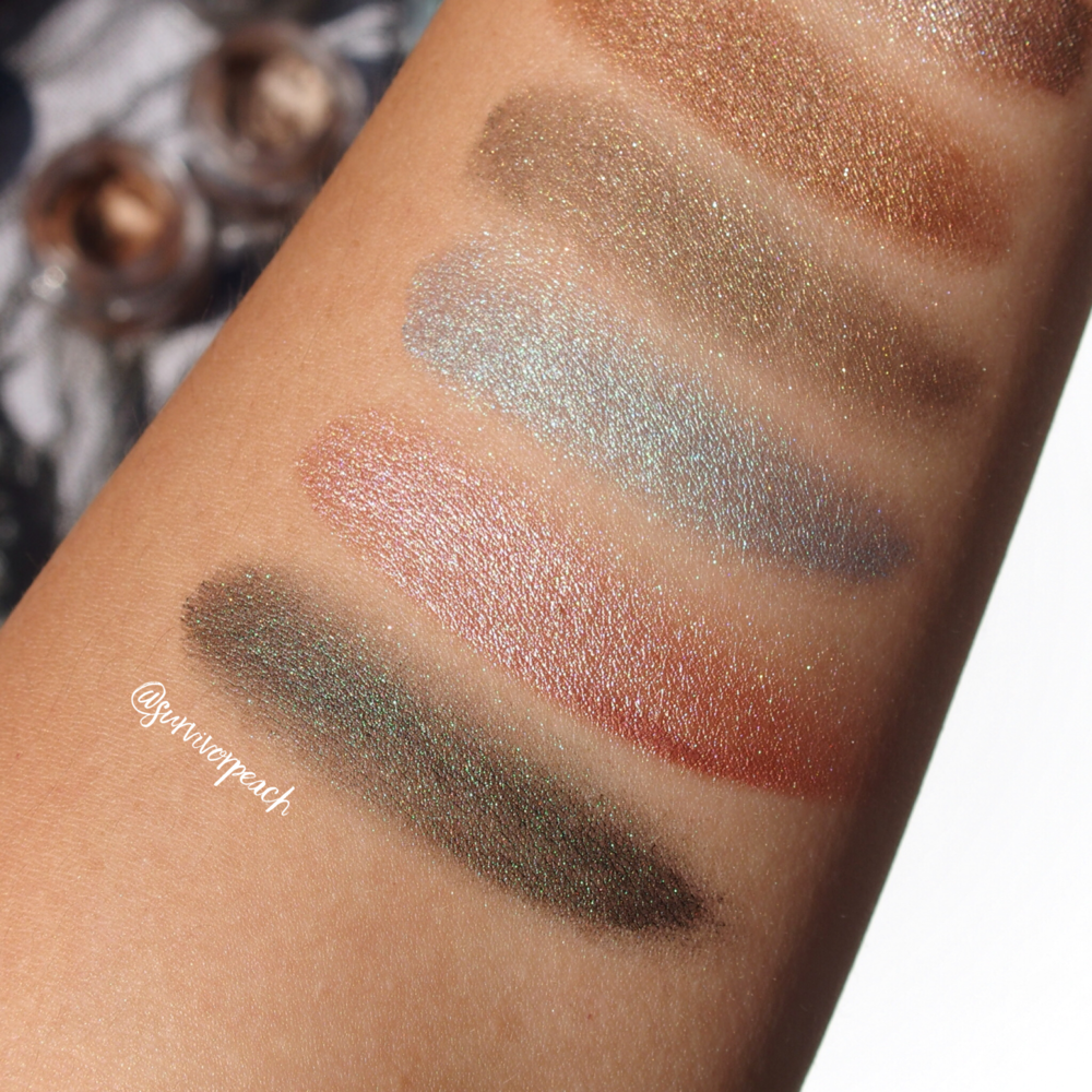 Tom Ford Creme Color for Eyes swatches from Bottom - Emerald Isles, Pink Haaze, Siren Blue, Burnished Copper, Spice.