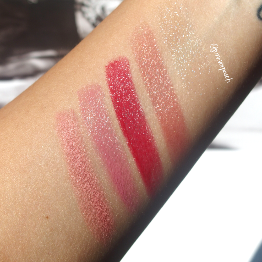 Swatches of the Surratt Prismatique Lips in shades Diamantee and Haute Monde, Lipslique   in shade Pom Pon and Rubis, and Automatique Lip Crayon in shade Gentillesse.
