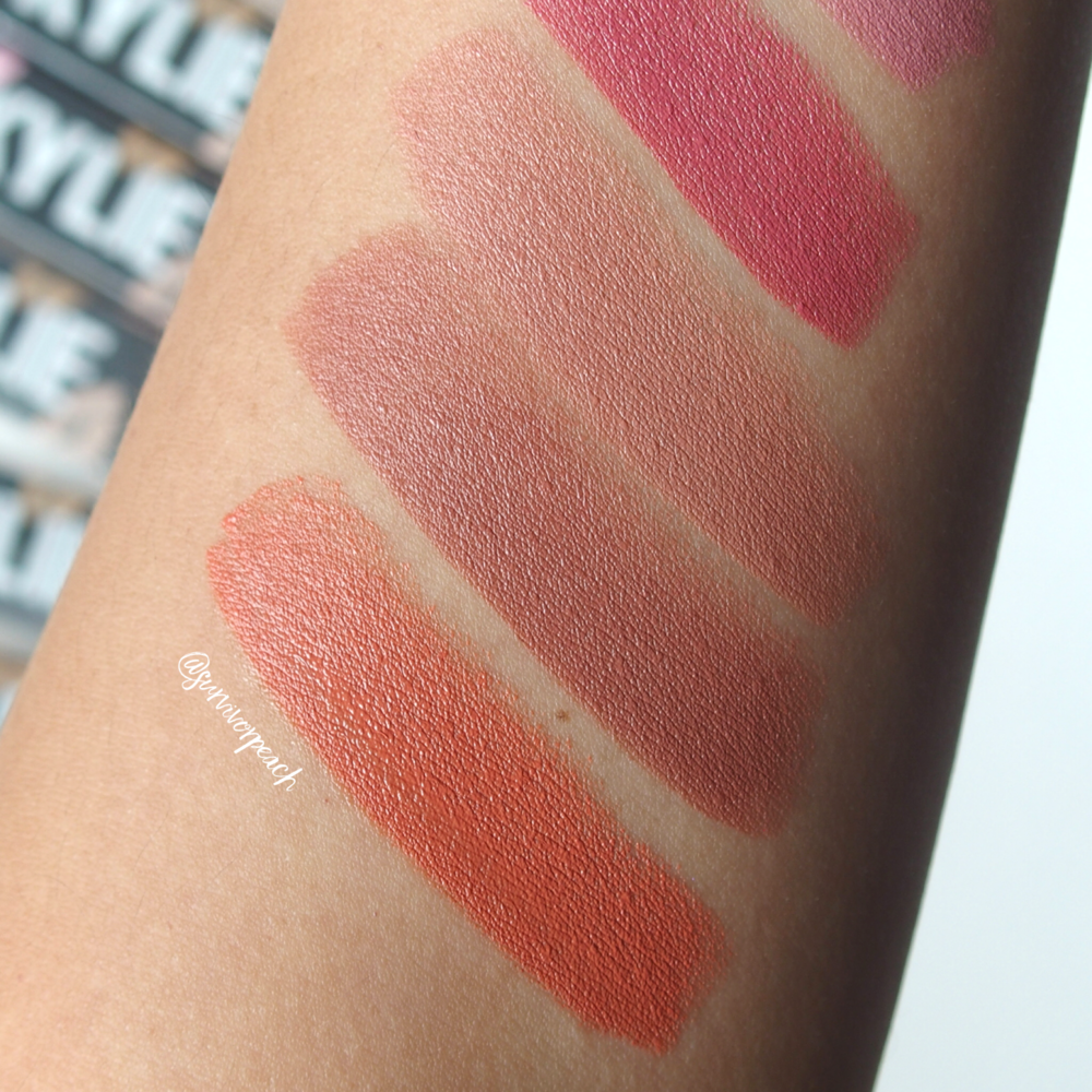 Swatches of the Kylie Cosmetics Creme lipstick in shades Butterscotch, Dulce De Leche, Sherbet