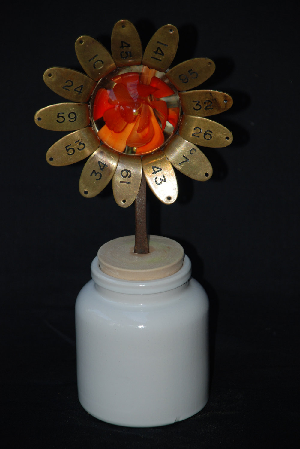 Orange and brass flower