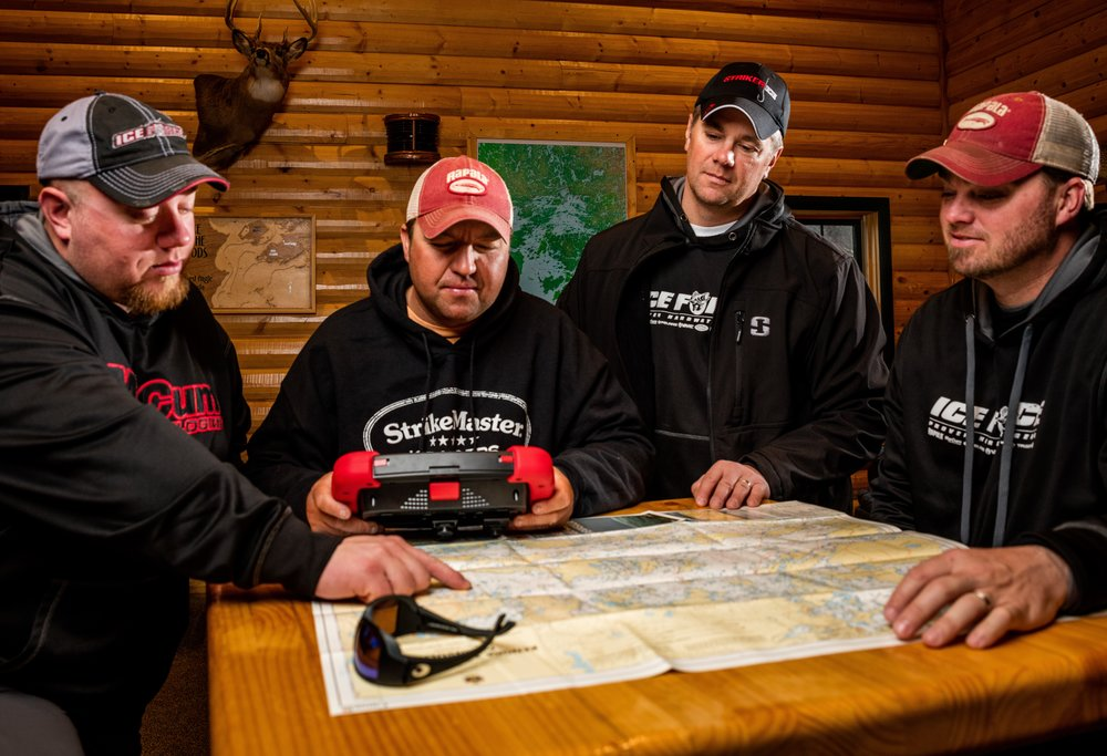 A combination of paper maps and digital mapping as seen on the Navionics-capable Marcum RT-9 make all the difference when traveling to any fishing destination.  Photo Credit - Ben Larson - In Depth Media Productions
