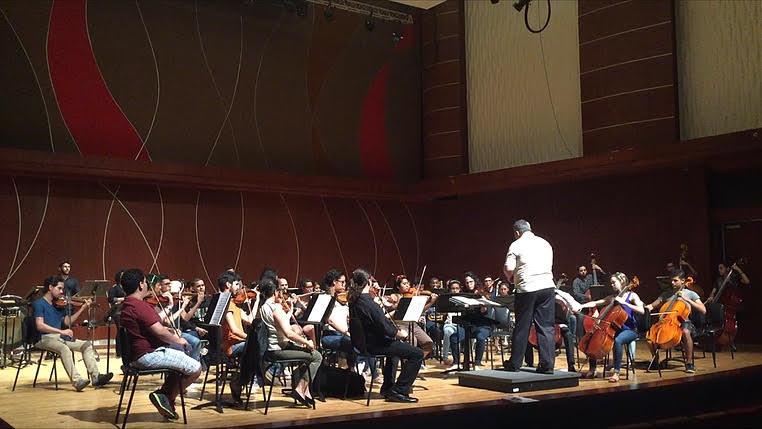 Maestro Rafael Enrique Irizarry Reahersing Gershwin's An American In Paris