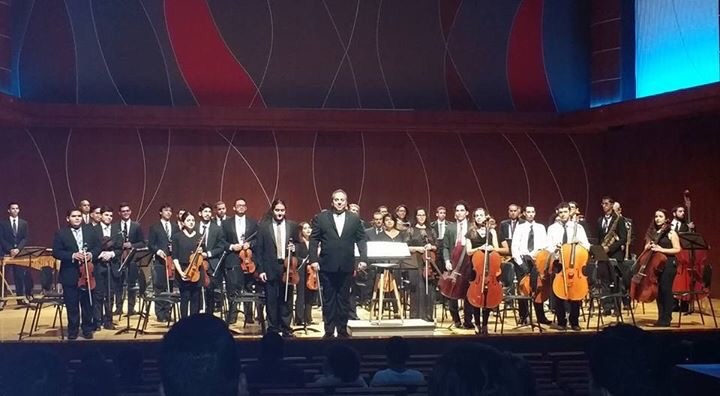 New Symphonic Orchestra with Maestro Rafael Enrique Irizarry after performing Gershwin's An American In Paris.