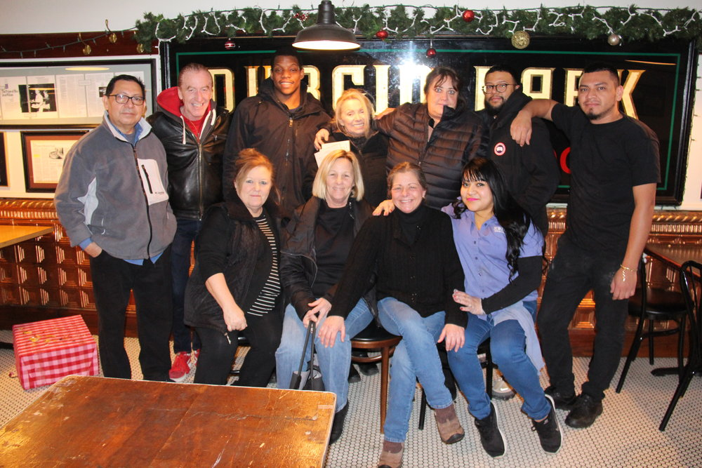Staff pose in front of the iconic Durgin Park Market Dining Rooms sign for what may be one of their last group photos. From left to right (back row): Felix Hernandez, Frank Cirigliano, Anthony Lenox, Gina Schertzer, Laura Seluta, Martial Merino and Chris Perez. From left to right (front row): Allison Dunbar, Judy Almonti, Barbara Muir and Ladley Rosa. Photo: Karen Bento
