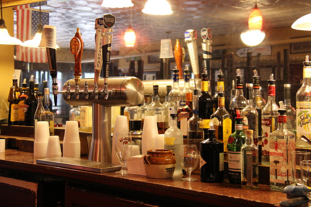 Saturday, Jan. 12, 2019 marked the last night patrons could sidle up to the bar at the Gas Light Pub and order John Durgin Ale (est. 1826) on tap. An empty, ceramic beanpot hides amid stemmed lager glasses and bottles of liquor left over from the restaurant's last night of revelry. Photo: Karen Bento