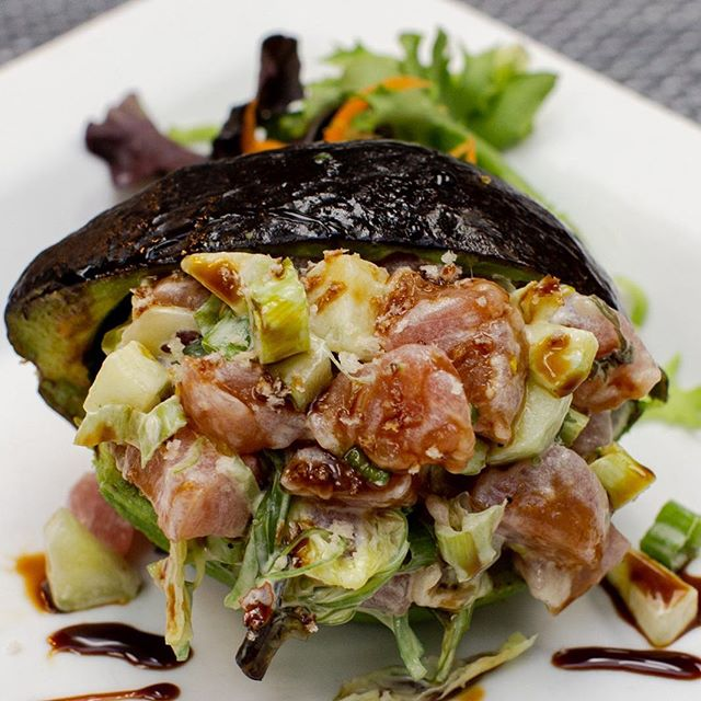 Tsunami Tuna served in a Grilled Avocado, just one of the delicious menu items being served tonight!! Catch Happy Hour from 4p-6p and unwind with us!! #hottunavb #shoredrivevb #locallove #deliciousness