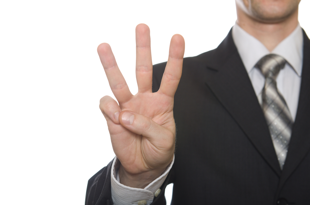 Business-Man-Holding-Up-Three-Fingers