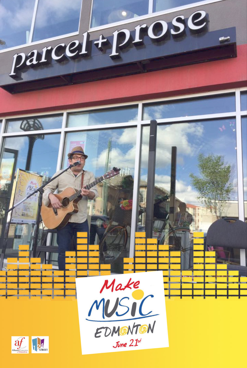 Local Musician Ben Sures performs in front of parcel + prose at the Make Music Festival 2017