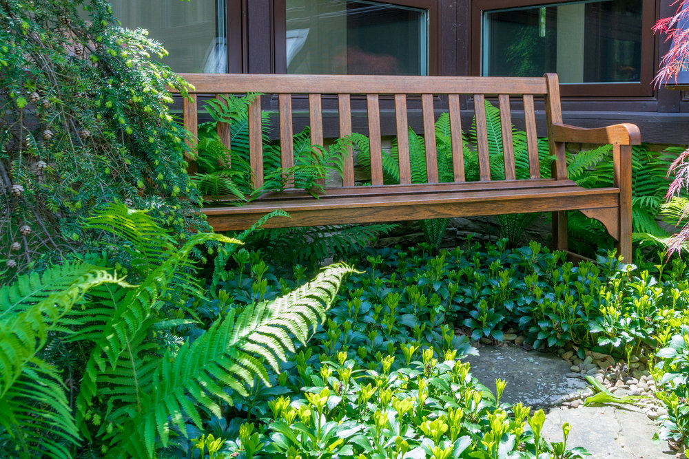 Relaxing on the bench in the courtyard is a great way to spend the afternoon.