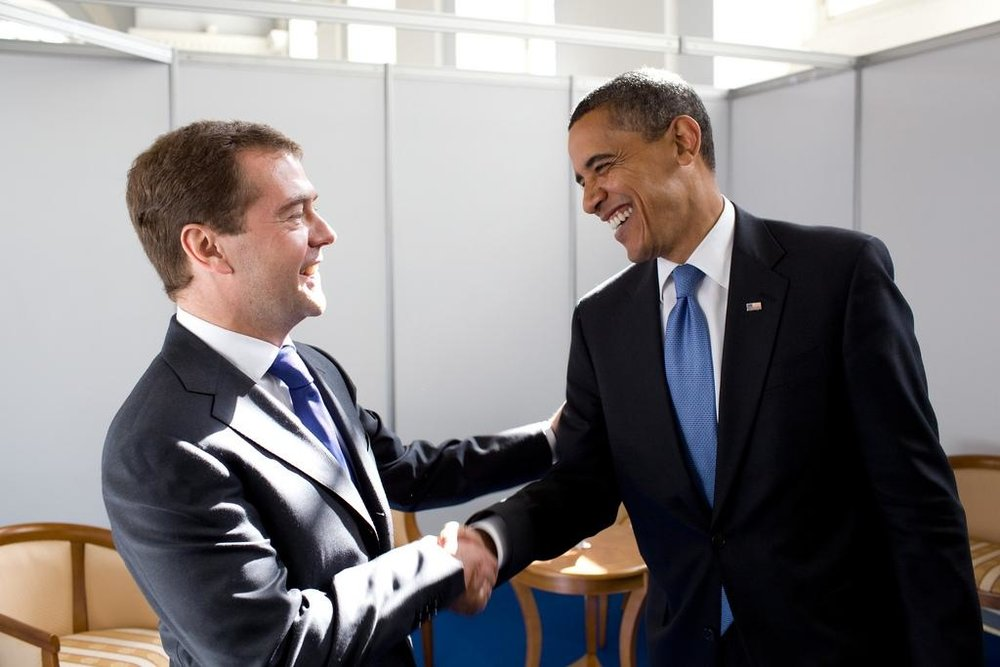 Russian President Dmitry Medvedev and US President Barack Obama meet at a business forum in 2009 | White House Photograph