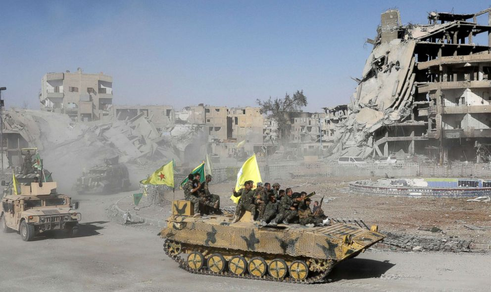 Syrian Democratic Forces (SDF) celebrate victory in Raqqa, Syria. || Erik de Castro, Reuters.