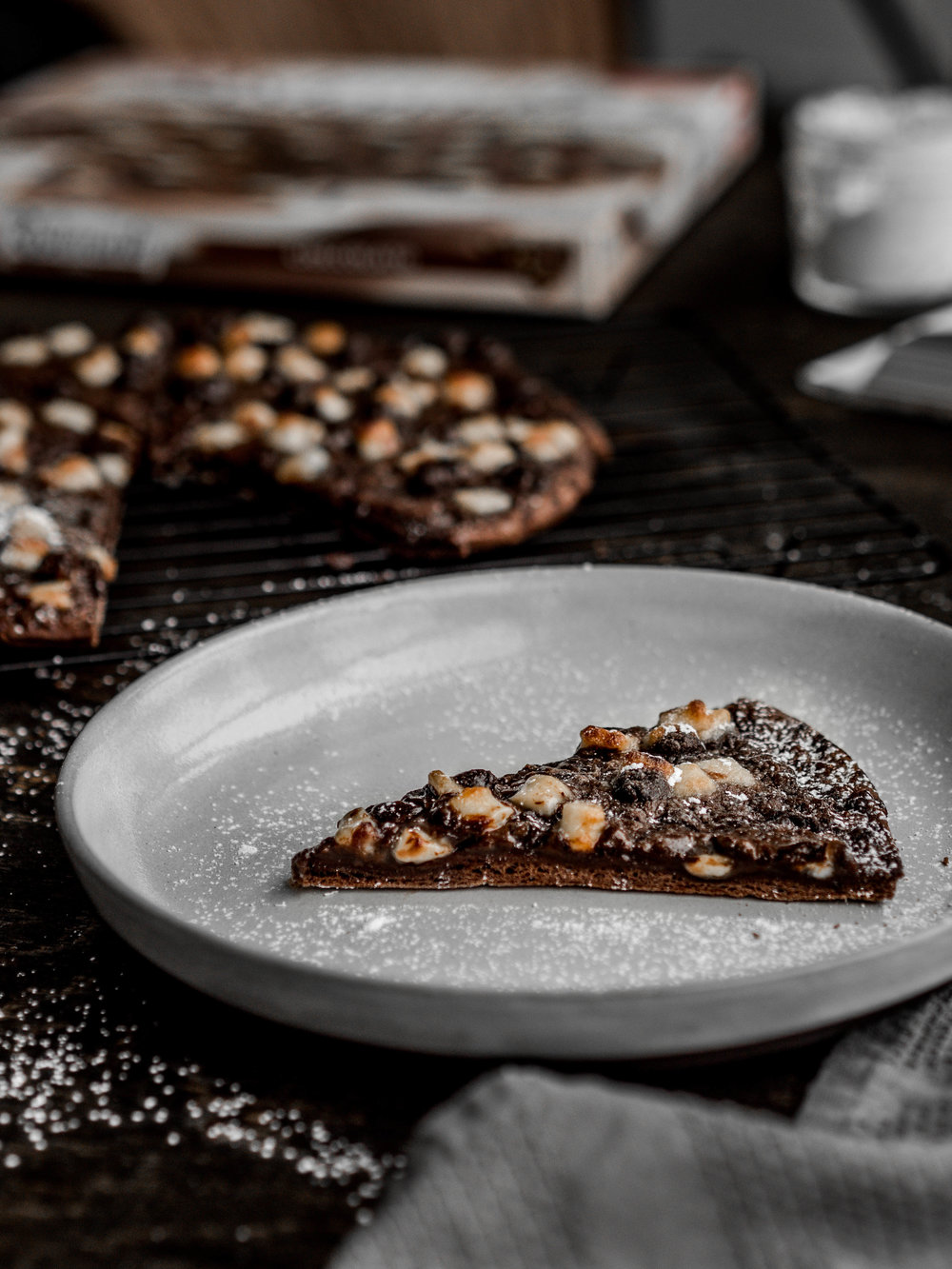 the perfect slice. - Crispy chocolate thin crust base, chocolate sauce, white chocolate chunks, milk chocolate shavings and lastly, dark chocolate chips.