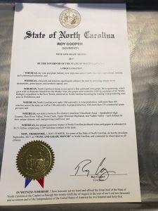 "The official proclamation signed by Gov. Cooper for ""NC Wine and Grape Month"""