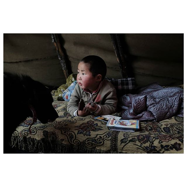 sugar monster . with the closest store 5 hours horseback ride away, this little guy doesnt get to have chocolate too often. he devoured the entire bar in minutes . #teepeelife #therealnomads #reindeerherder #tsataan #tuvan #nomads #centralasia #taiga #northernmongolia #mongolia