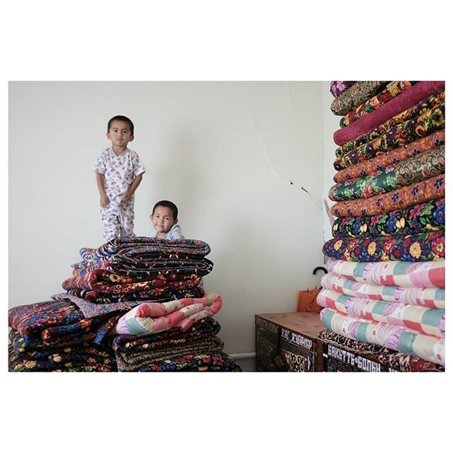 double trouble . someone was not so happy about this two making a Mattress Mega Castle of Fun while they were fitting us for 'maksi' (leather socks used by muslims so that they don't have to perform feet ablution if conditions for it are not optimal like being at work, harsh weather, travelling...) we just wanted to be done quickly so that we could go play too ! . #playgroundsoftheworld #kidstheyjustwannahavefun #bouncycastle #doubletrouble #localsoftheworld #mattressfun #centralasia #travelcentralasia #silkroad #travelgram #taraz #kazakhstan