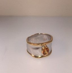 Sterling silver citrine ring with gold plate detail. $300