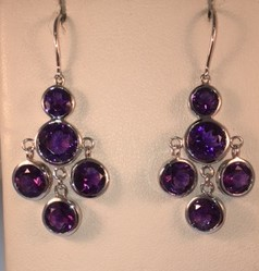 Sterling silver and amethyst dangle earrings. $675