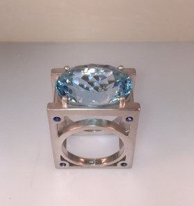 Wowza! 23.62 carat blue topaz ring! Set in sterling silver with .36 carat total weight blue sapphire accents. $1380