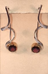 Sterling silver garnet dangle earrings with gold plate detail. $345