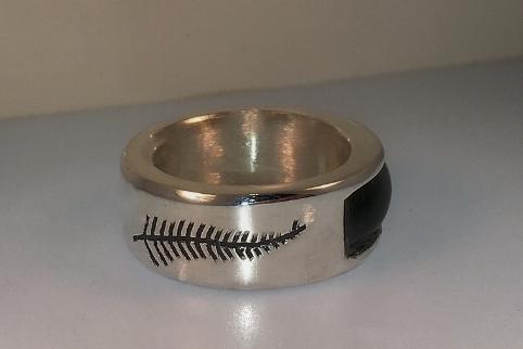 Fabricated silver band with hand-carved leaf detail and jade center stone.