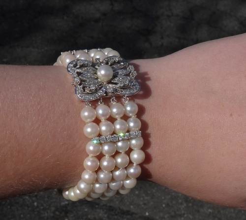 "Vintage 14k white gold diamond and pearl bracelet. 7.5"". $3,000."