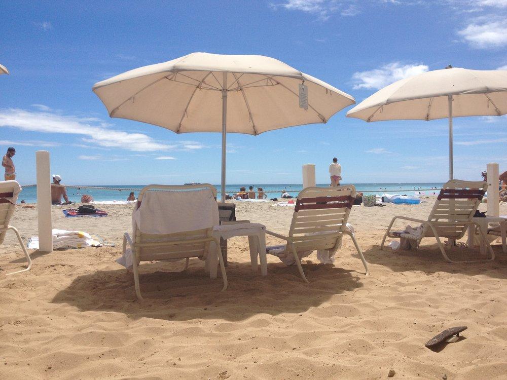 Moana Surfrider umbrella rentals.jpg