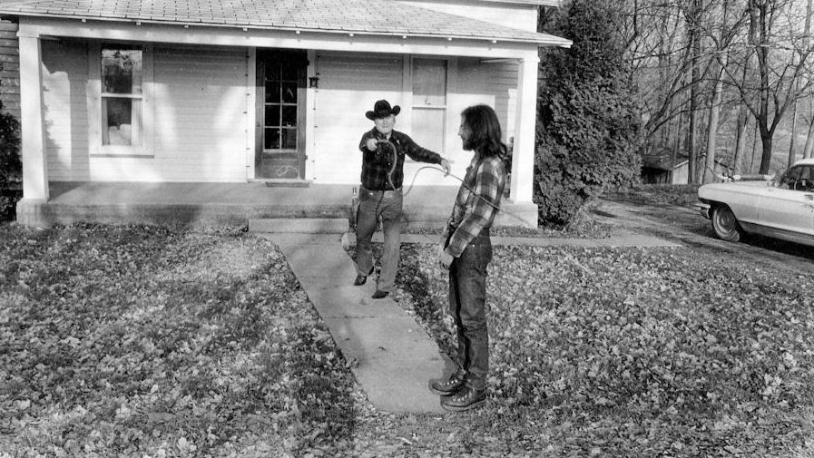 Tex demonstrates his whip skills on a brave volunteer named Mike Melnyk. This photo, circa 1973, is at Tex's house in Mansfield, In.
