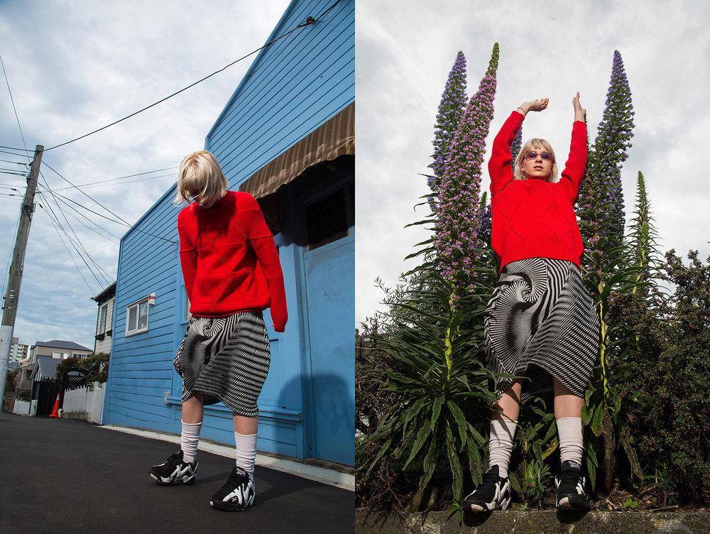 Sunglasses: Moschino Jumper: Junya Watanabe x Comme des Garçons Skirt: Issey Miyake Socks: Nike Trainers: Reebok