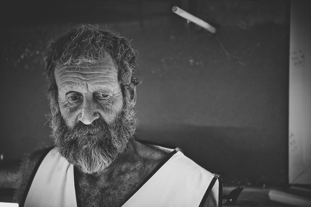 Tony Hardy Portrait. I have surfed with Tony out at Margaret River Main Break and here is shaping a single fin for me, when I first looked at this image all I could see was history in those facial lines, Tony is an iconic person around the area and everyman and his dog seem to have some strange story of his life.