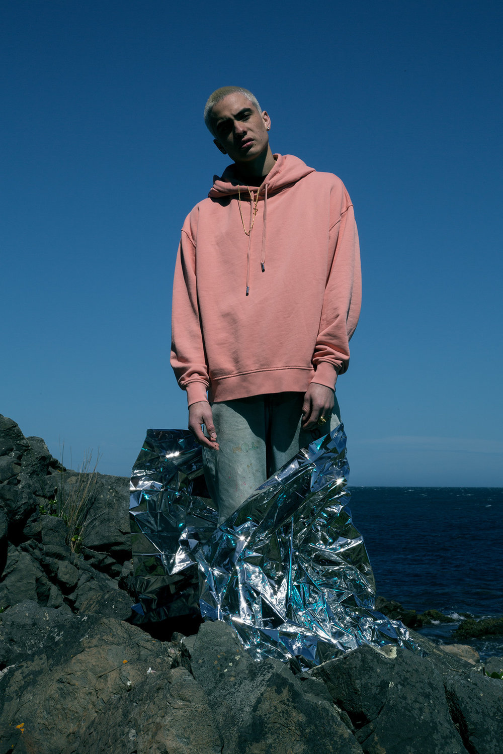 Hunter: Acne Studios hoodie, Warehouse jeans, models own jewellery.