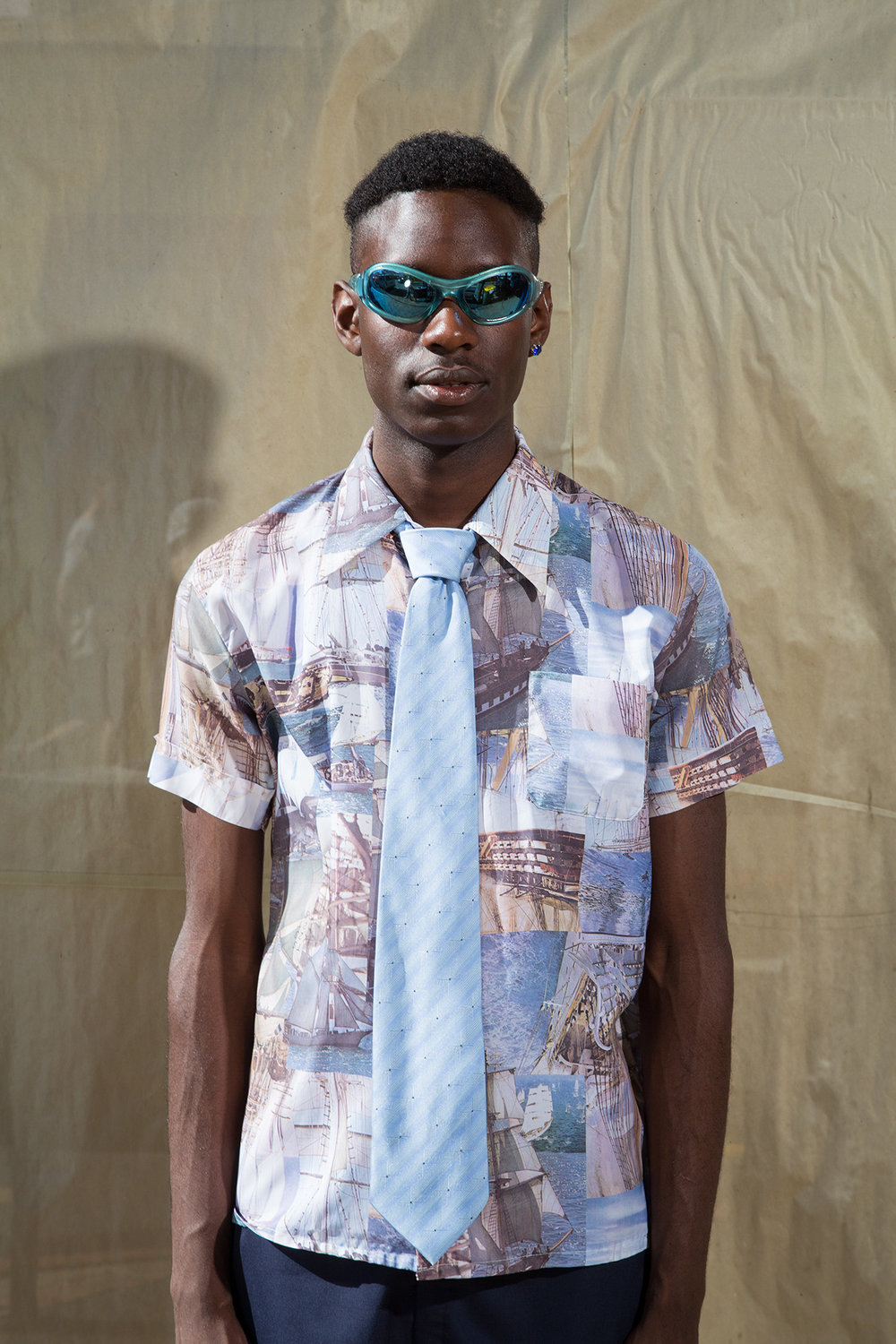 Vintage shirt from Tangent & Co, stylists own necktie and Sunglasses, models own jewellery.