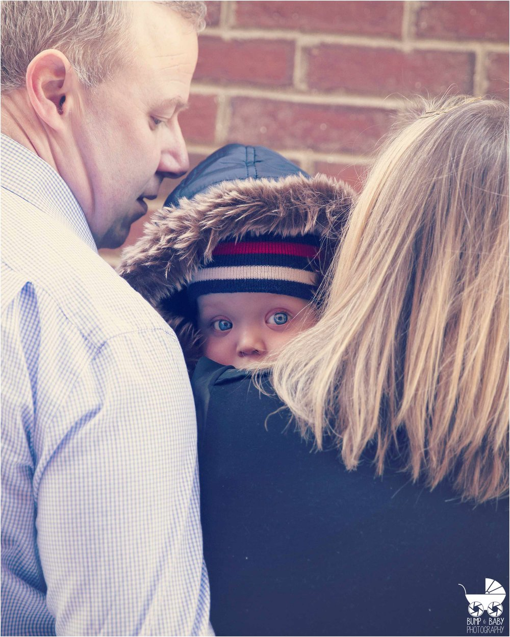 7_Month_old_Baby_boy_with_parents_boston_winter_bright_blue_eyes_Lifestyle_Session.jpg