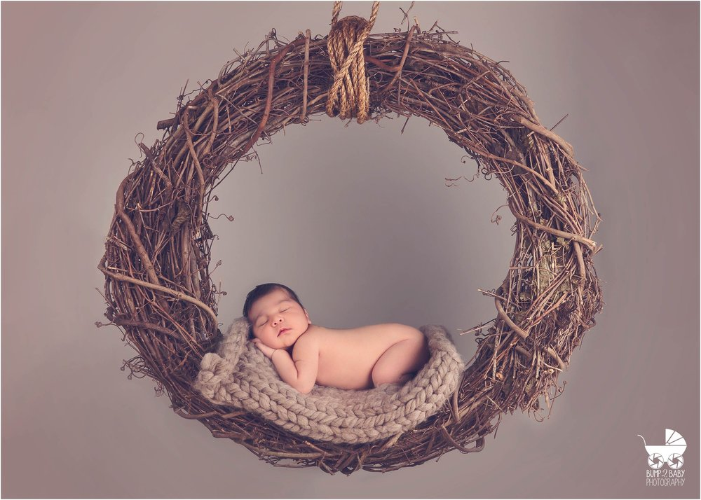 Newborn Baby Boy on Wreath Swing