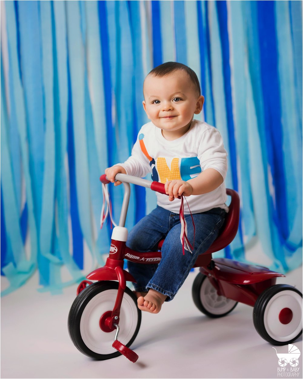 Cake_smash_session_baby_boy_Blue_themed_birthday_portrait_red_bike.jpg