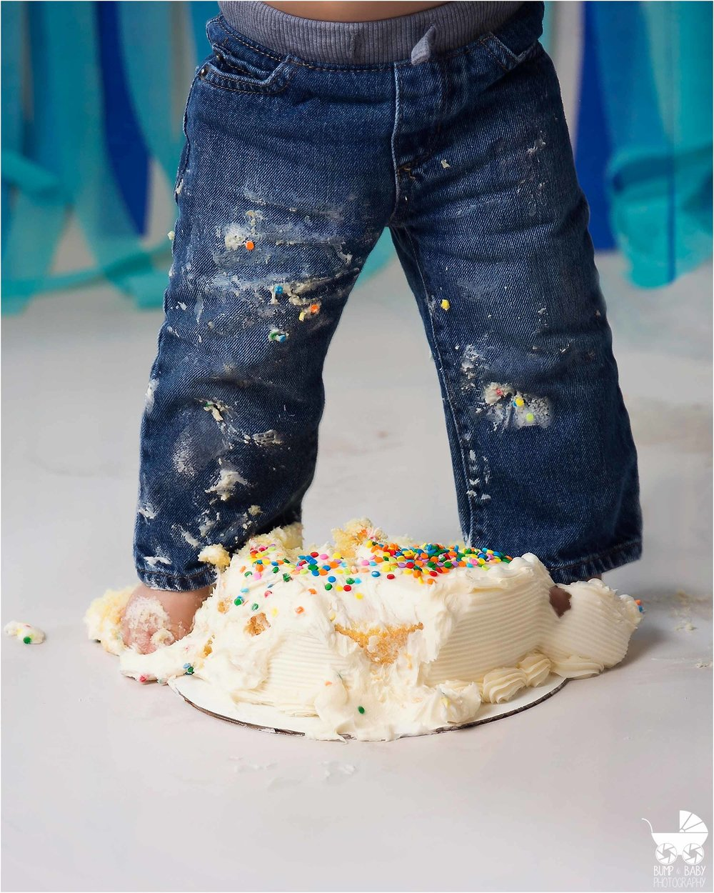Cake_smash_session_baby_boy_Blue_themed_standing_in_cake.jpg