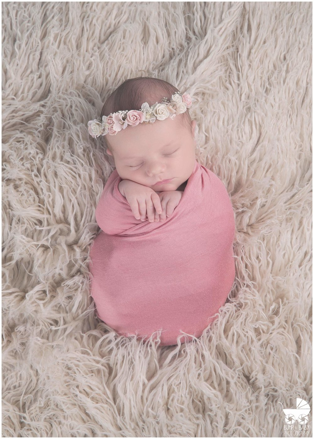 Newborn-baby-girl-swaddled-with-floral-crown.jpg