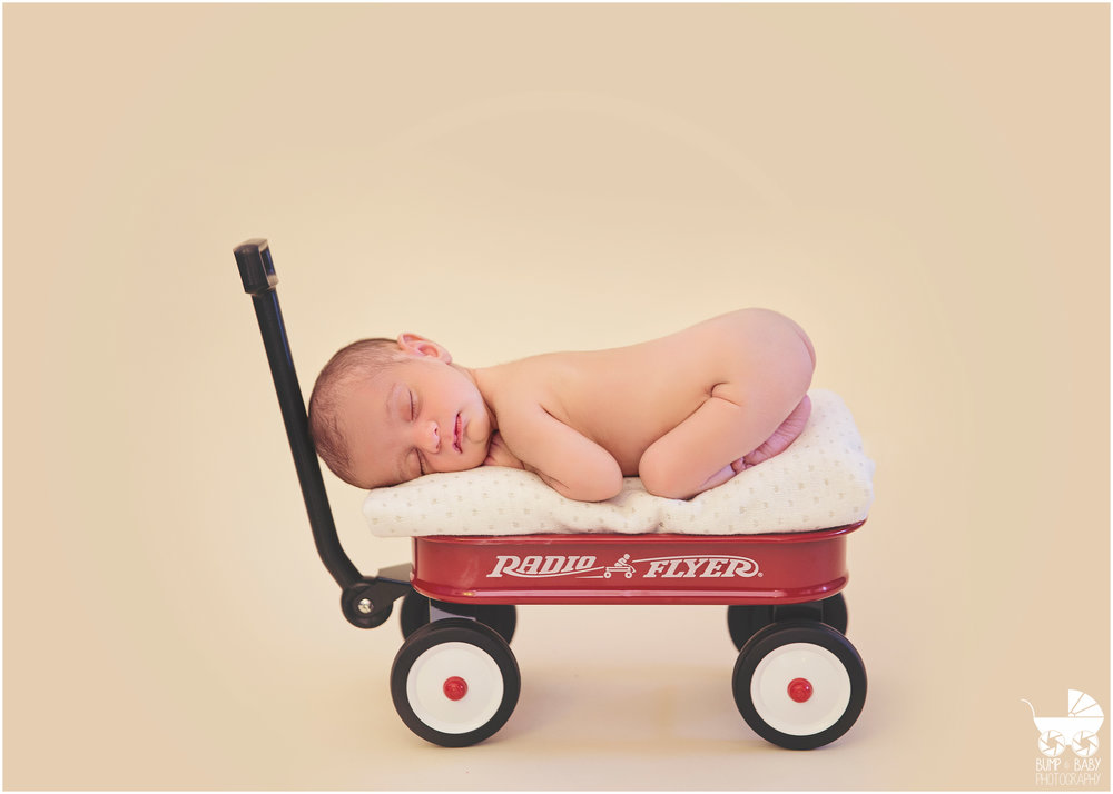 Newborn-Baby-Girl-in-red-wagon.jpg