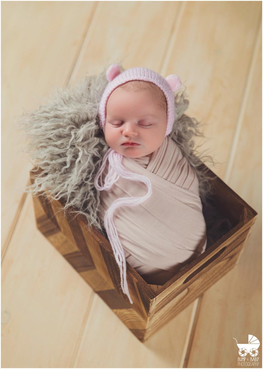 Newborn-Baby-Girl-in-teddy-bear-bonnet.jpg