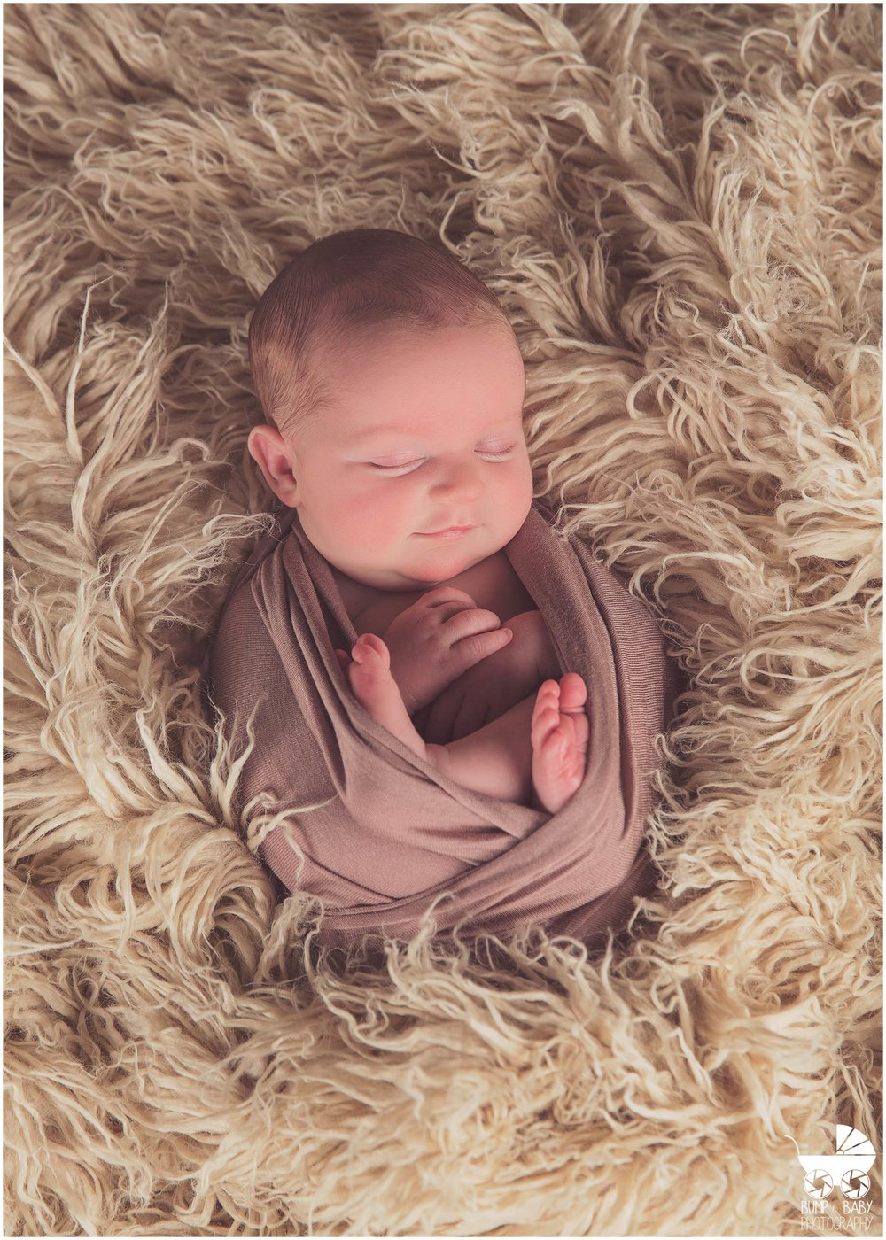 Newborn-Baby-Girl-Neutral-Colors-Wrapped-on-Fur.jpg