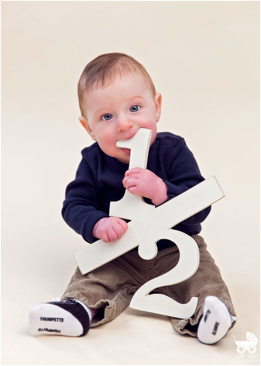 6-Month-Old-Baby-Boy-chewing-on-half-sign.jpg