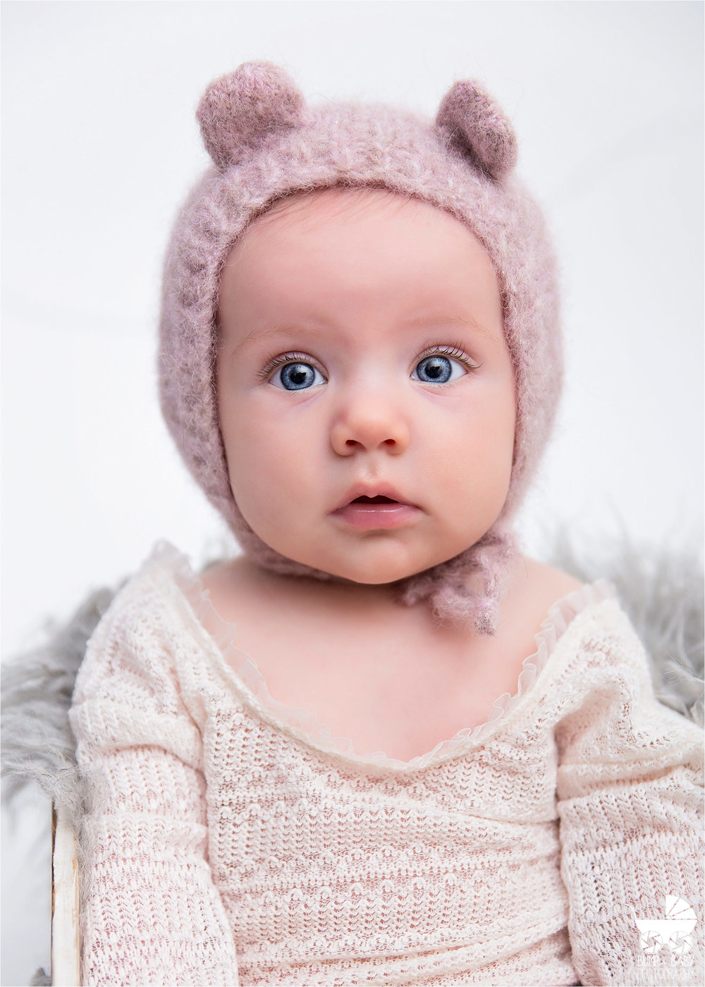3-Month-Old-Baby-Girl-with-Teddy-Hat-in-Crate.jpg