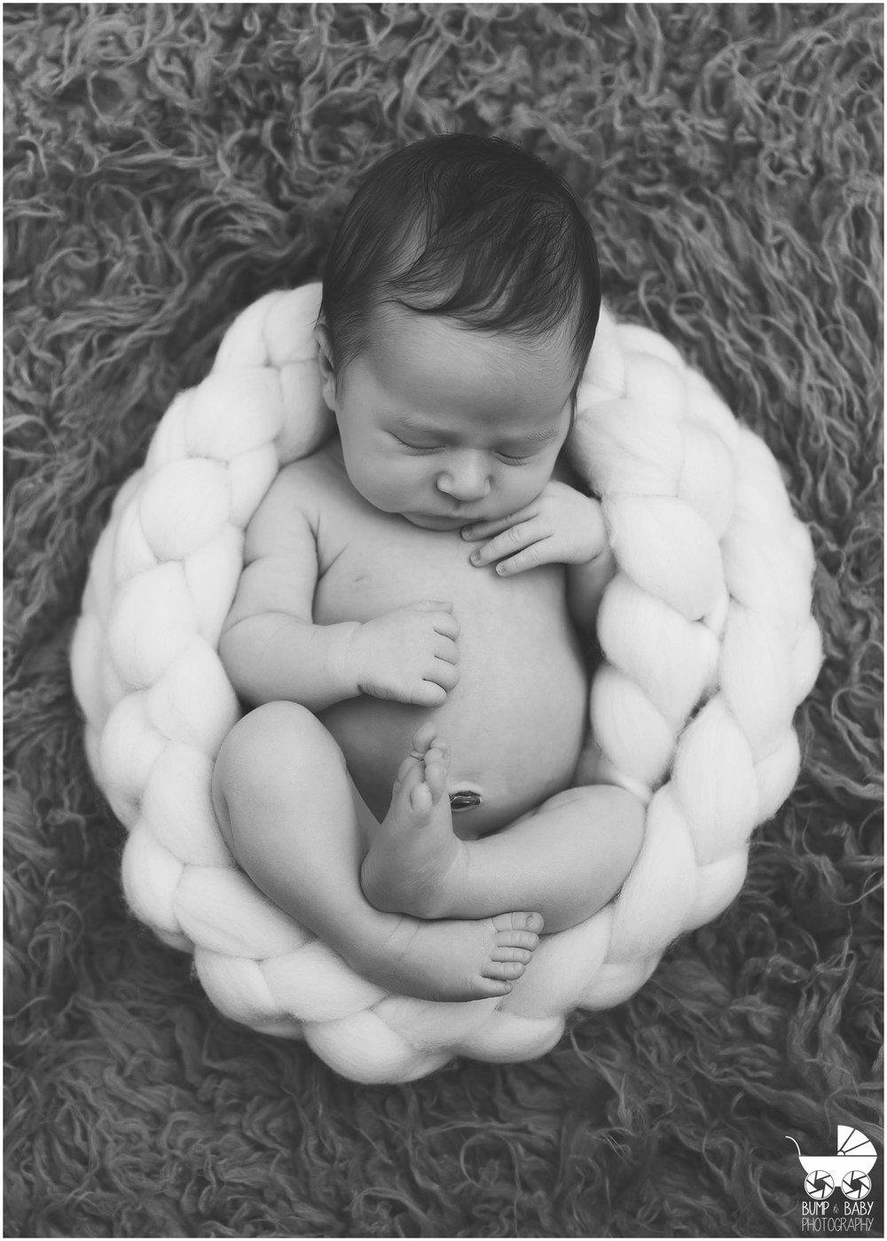 Newborn-Baby-Girl-in-Braided-bowl.jpg