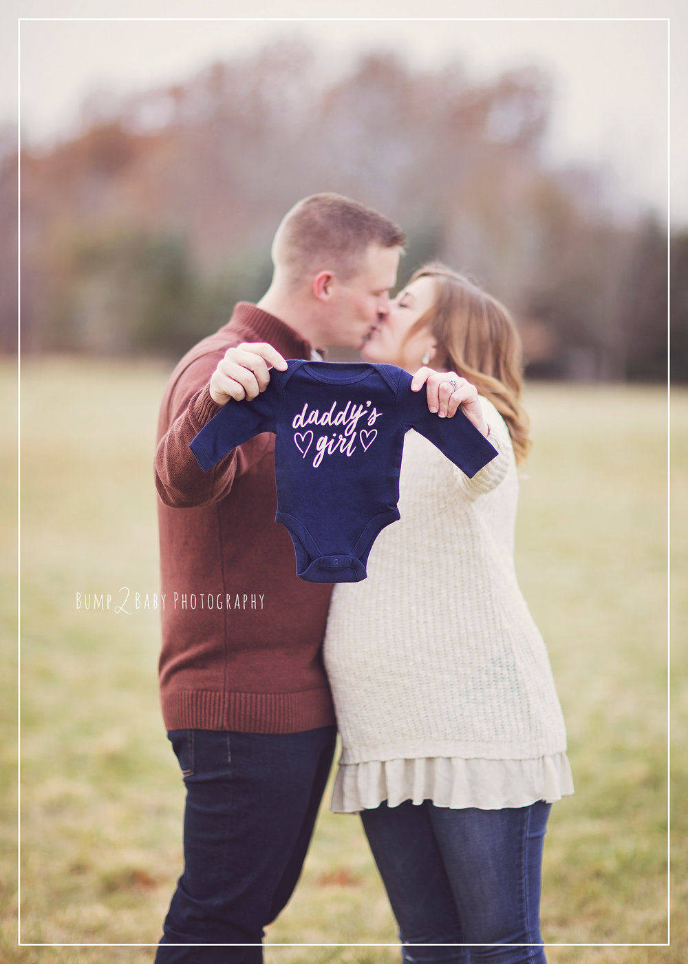 Maternity-Session-Parents-Holding-Daddys-Girl-Onesie.jpg