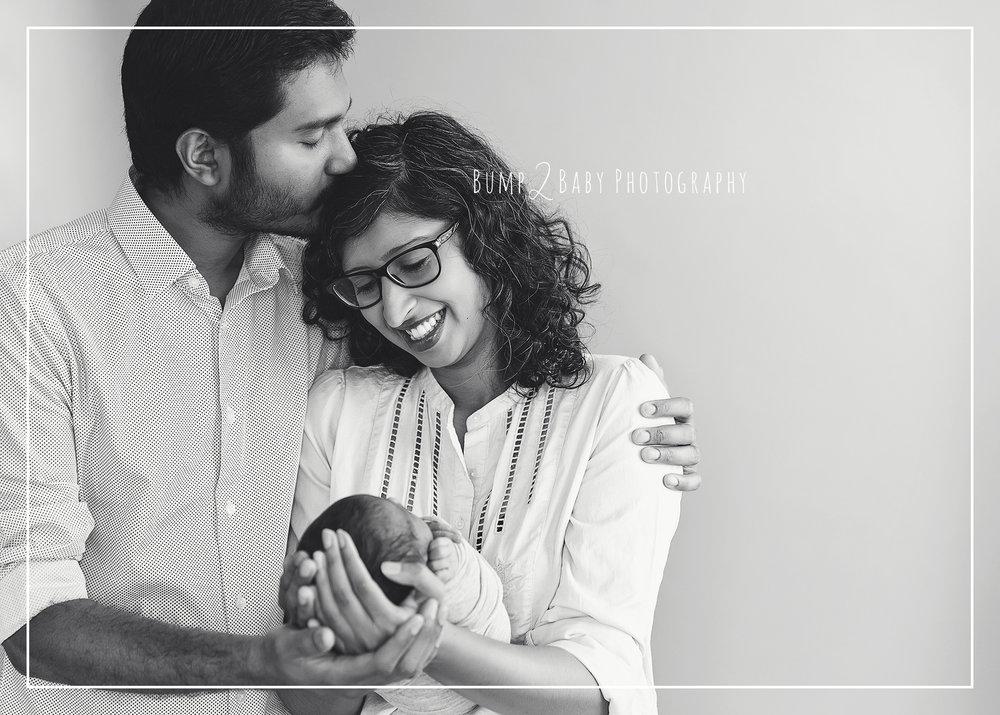 Parents-with-newborn-baby-boy-smiling.jpg