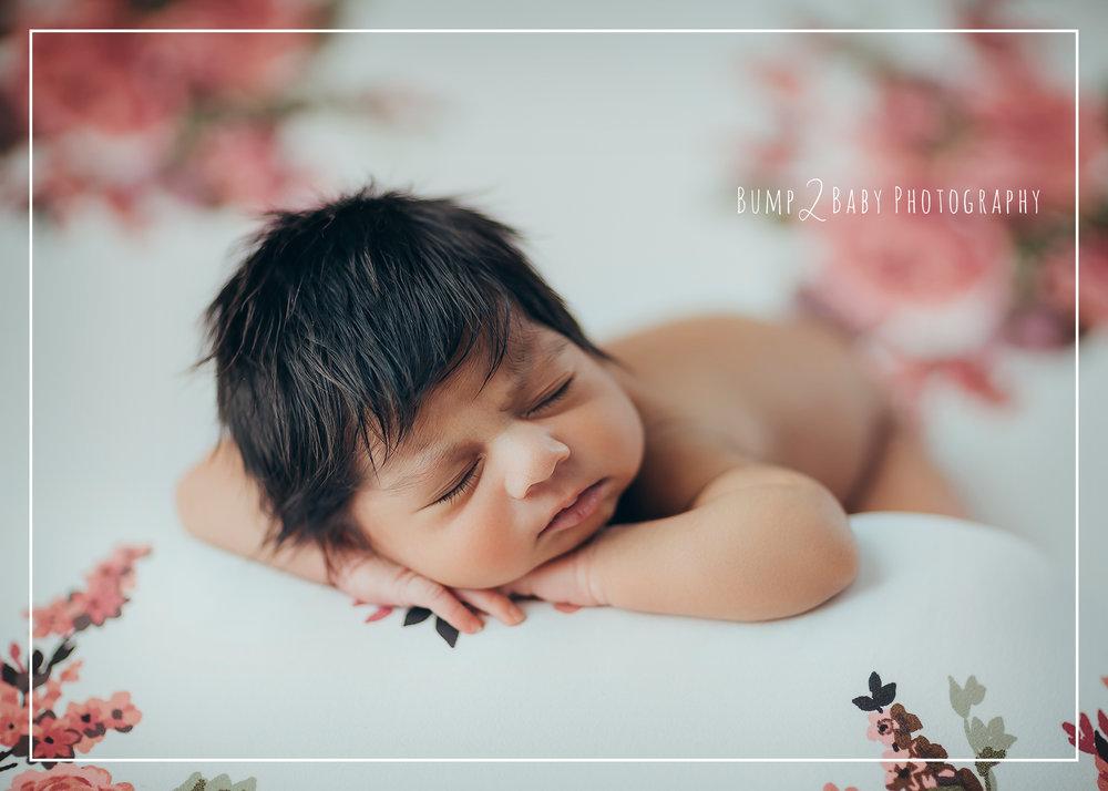 Newborn-Baby-Girl-on-Floral-Fabric-Backdrop.jpg